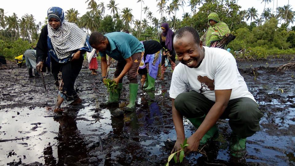 Mbarouk Planting tree.jpg